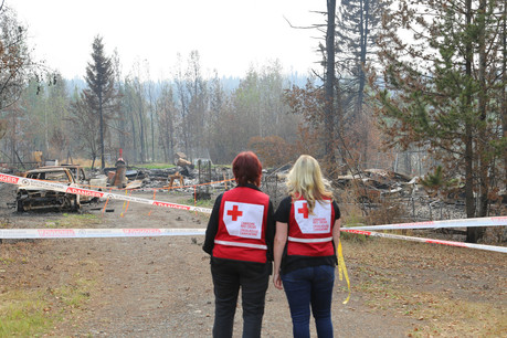 Red Cross workers look at damage from BC wildfires