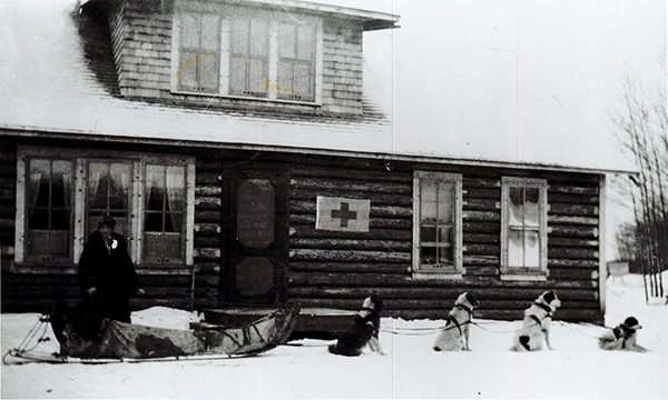 Outpost Hospital nurse with dog sled